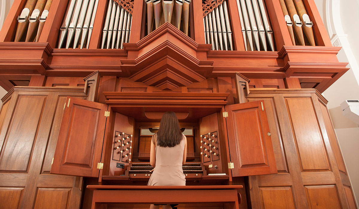 Student playing organ