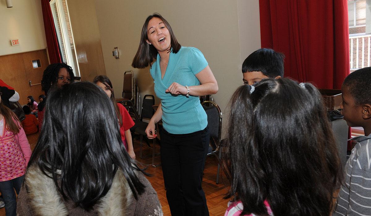 Student teaching music to children