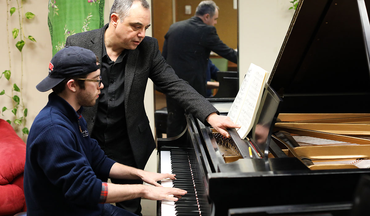 Student and professor at piano