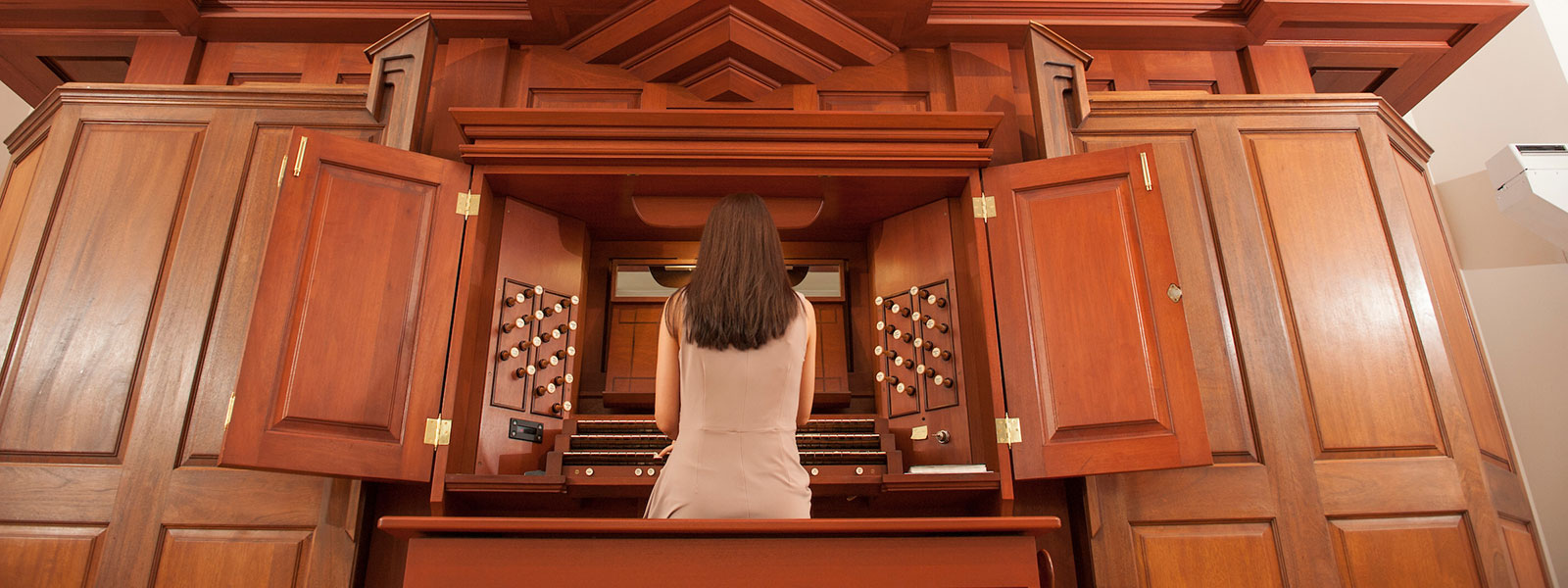 Student playing organ